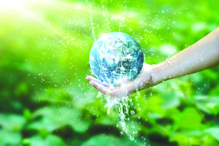 Water pouring on planet earth placed on human hand for saving resources and heal the world campaign, environment issues, Elements of this image furnished by NASA.